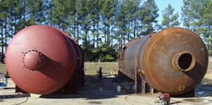 Two large composite autoclaves being field-built by ASC